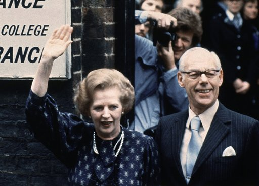 In this June 9, 1983, photo, British Prime Minister Margaret Thatcher leaves a London polling station with her husband, Dennis, after casting their votes in the general election.