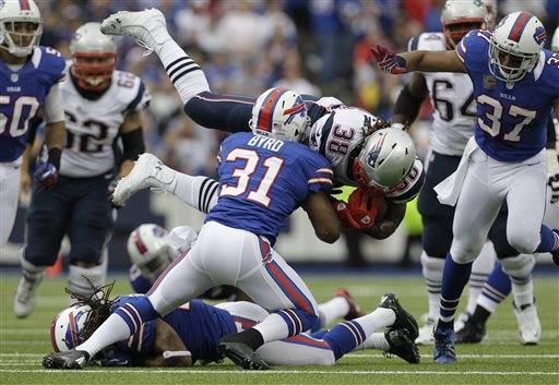 FILE - In this Sept. 30, 2012 file photo, Buffalo Bills' Jairus Byrd (31) upends New England Patriots' Brandon Bolden (38) during the first half of an NFL football game in Orchard Park, N.Y. Having not yet signed Buffalo's franchise-tag offer, Bills safety Jairus Byrd is not expected to attend the start of the team's three-day veteran voluntary minicamp that opens Tuesday, April 16, 2013. (AP Photo/Gary Wiepert, File)