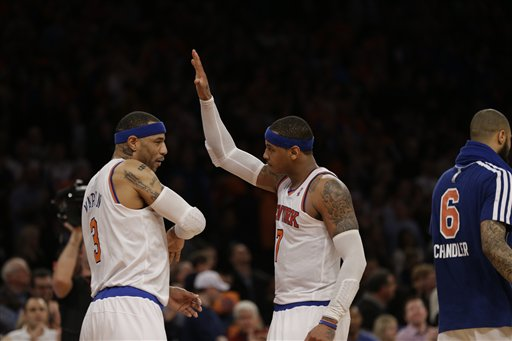 New York Knicks forward Kenyon Martin, left, and New York Knicks forward Carmelo Anthony celebrate near the end of the Knicks 85-78 victory over the Boston Celtics in the second half of Game 1 of the NBA basketball playoffs in New York, Saturday, April 20, 2013. (AP Photo/Kathy Willens)