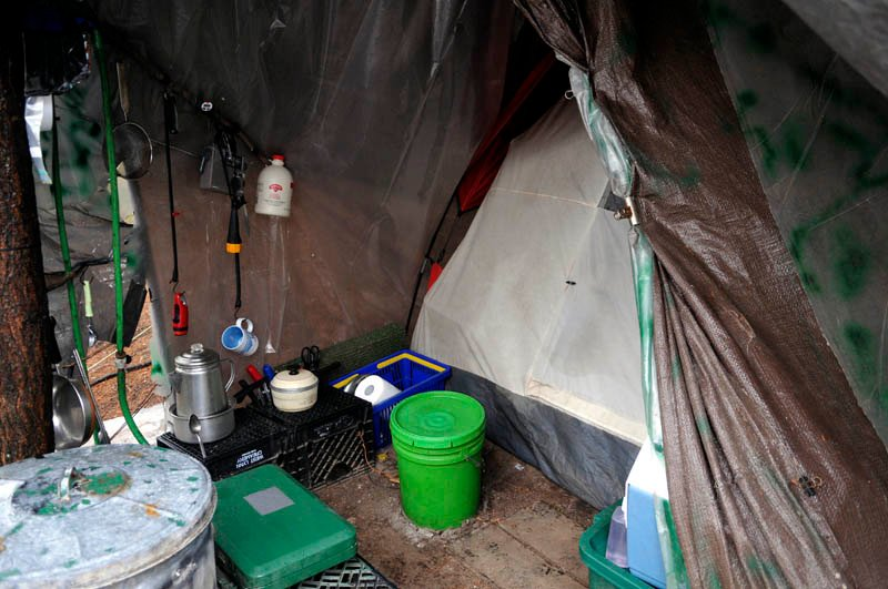 Christopher Knight's camp on Tuesday in a remote, wooded section of Rome. Knight kept camping supplies and a tent beneath a brown tarp where he lived, police say.