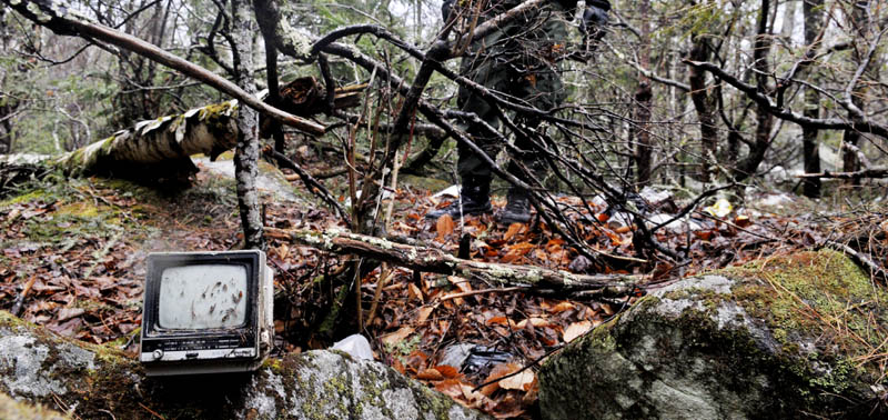 Staff photo by Andy Molloy A television found at Christopher Knight's camp on Tuesday April 9, 2013 in a remote, wooded section of Rome. Police believe Knight, who went into the woods near Belgrade in 1986, was a hermit who committed hundreds of burglaries to sustain himself.