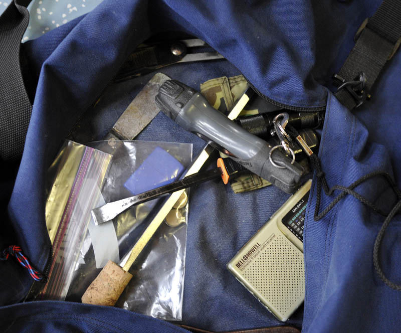 Staff photo by Andy Molloy Tools recovered in a bag that Christopher Knight was carrying when he was apprehended at Pine Tree Camp in Rome Tuesday April 9, 2013. Knight, a hermit who lived in the woods since April 1986, apparently utilized the tools to break into several dozen camps in the Belgrade area, according to police.
