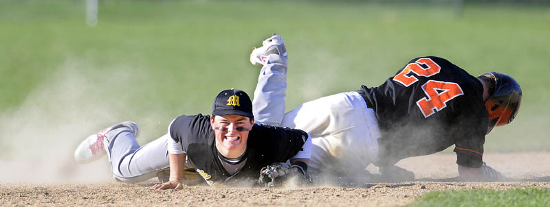 LOOK OUT: Winslow High School's Dylan Hapworth, right, slides into Maranacook Community School's Tucker Whitman at second base Tuesday in Readfield. Hapworth made it safely to the base. The Black Raiders won 12-5.