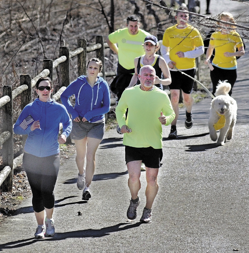 Runners and walkers head down the Kennebec Rail Trail in Hallowell Wednesday to show solidarity with people injured in the blasts at the Boston Marathon on Monday. About two dozen people made a trip to Augusta and back.