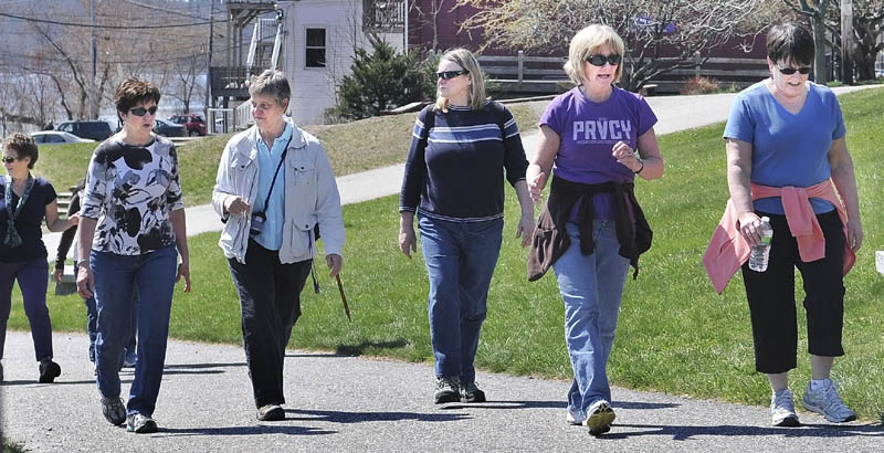Members of the Maine International Adventure Club walk up the Kennebec River Rail Trail Sunday in Hallowell. The Club is planning a trip to Ireland.
