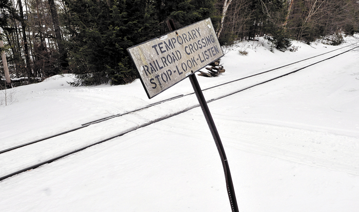 Snow covers the railroad crossing on Dustin Drive in Belgrade on Feb. 19. A bill that would have settled liability for railroad crossings on private land — and might have helped mitigate increased crossing fees being charged by Pan Am Railways — has been tabled.