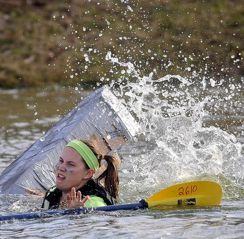 Rebecca Fisher, 20, struggles to stay afloat in the fourth heat during the first cardboard kayak race at Unity College on Friday.