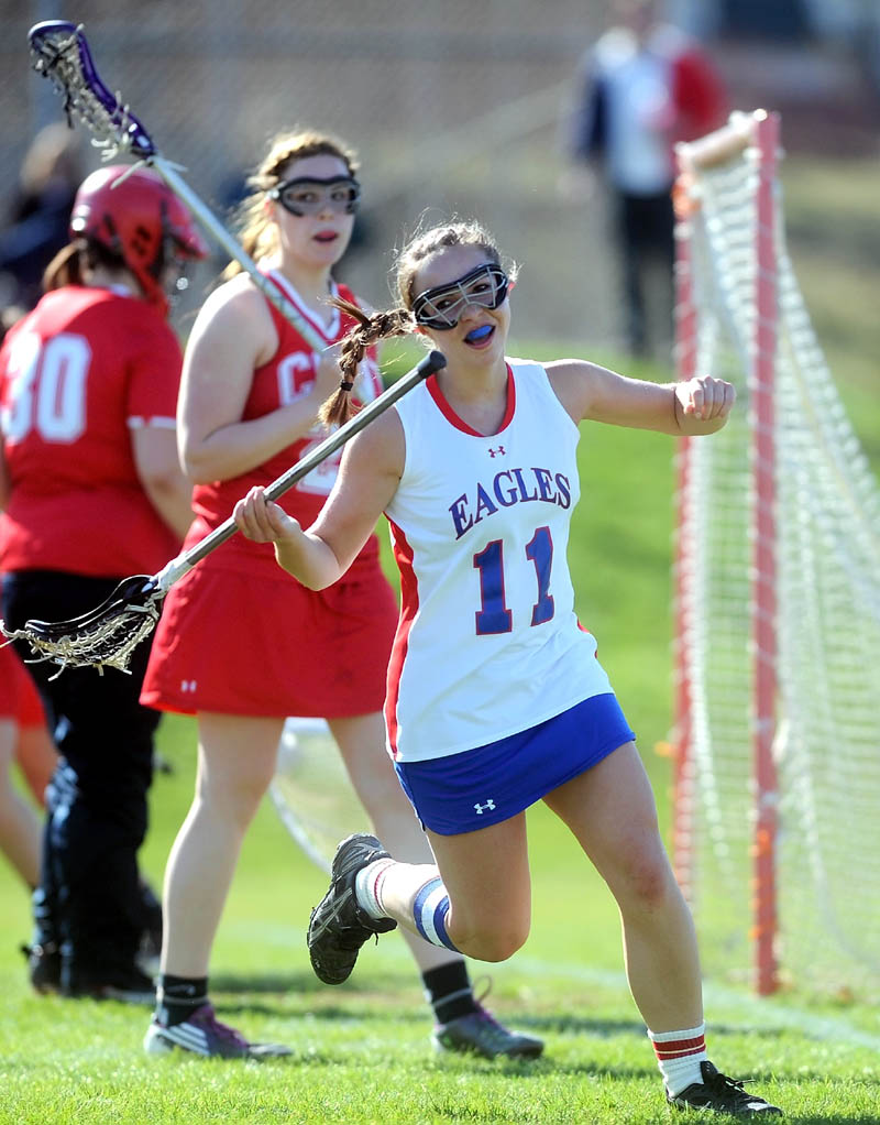 THAT'S A GOAL: Messalonskee's Sydney Gagne (11) celebrates her first period goal during the Eagles' 10-9 win over Cony on Thursday at Messalonskee High School in Oakland.