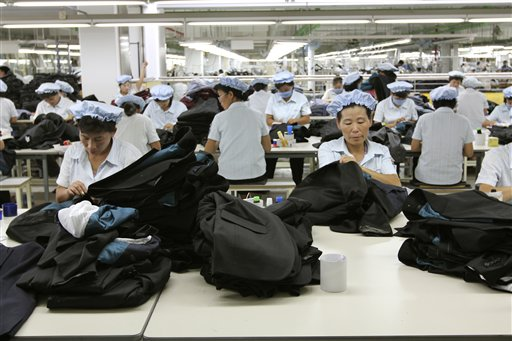 In this Sept. 21, 2012, photo, North Korean workers assemble Western-style suits at the South Korean-run ShinWon Corp. garment factory inside the Kaesong industrial complex in Kaesong, North Korea.