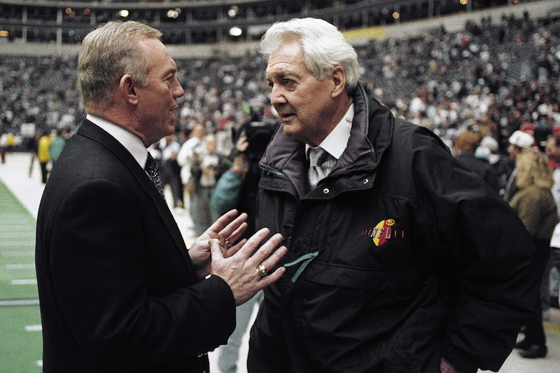 In this Jan. 23, 1994, file photo, Dallas Cowboys owner Jerry Jones, left, talks with CBS commentator Pat Summerall before the NFL football NFC championship game between the Cowboys and the San Francisco 49ers in Irving, Texas. Fox Sports spokesman Dan Bell said Tuesday, April 16, 2013, that Summerall, the NFL player-turned-broadcaster whose deep, resonant voice called games for more than 40 years, has died at the age of 82. (AP Photo/Ron Heflin, File)