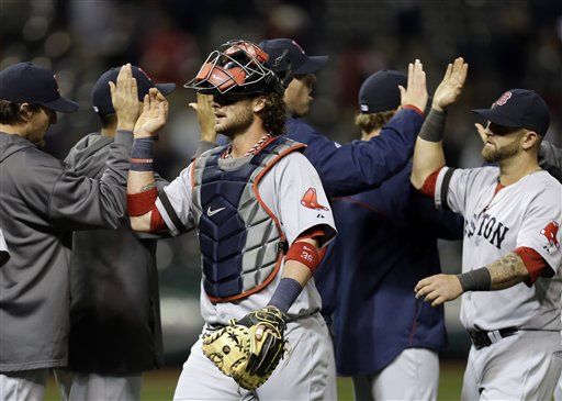 Boston Red Sox catcher Jarrod Saltalamacchia, center, celebrates with teammates after a 6-3 win over the Cleveland Indians in a baseball game Wednesday, April 17, 2013, in Cleveland. (AP Photo/Mark Duncan) Progressive Field