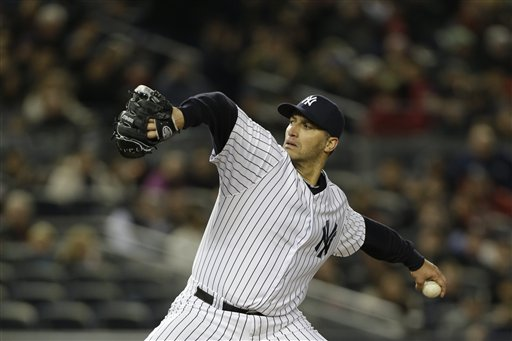 New York Yankees starting pitcher Andy Pettitte winds up against the Boston Red Sox in a baseball game at Yankee Stadium in New York, Thursday, April 4, 2013. (AP Photo/Kathy Willens)