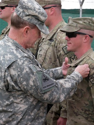 U.S. Chairman of the Joint Chiefs of Staff, Gen. Martin Dempsey, pins a Combat Infantrymen Badge on an unidentified soldier at Forward Operating Base Sharana in Afghanistan's Paktika province during his visit to the base Sunday.
