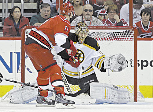 STOPPED: Carolina's Jordan Staal's shot is blocked by Boston's Tuukka Rask during the first period Saturday in Raleigh, N.C.