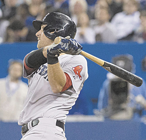 GOING DEEP: Boston's Will Middlebrooks watches the flight of the ball as he hits a home run off Toronto starter R.A. Dickey during the fifth inning Sunday in Toronto. Middlebrooks was 4 for 5 with three home runs, a double, four RBIs and four runs scored.
