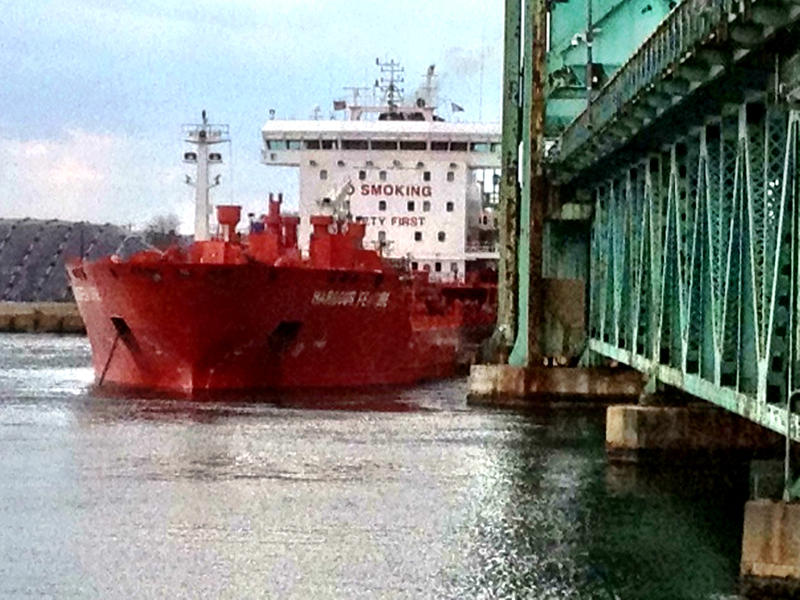 The incoming tide presses the tanker Harbour Feature against the Sarah Mildred Long Bridge in the Piscataqua River Monday.