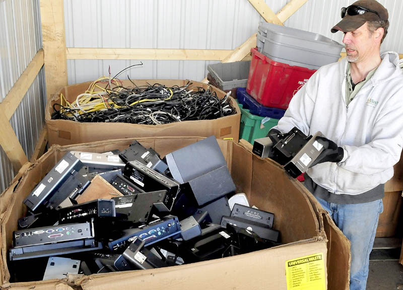 Skills Inc. Recycling Center Manager Ray Buker sorts electronic equipment to be recycled at the Waterville facility.