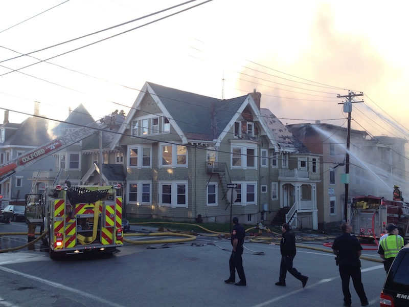 Firefighters battle a blaze in Lewiston on Monday that has consumed multiple buildings.