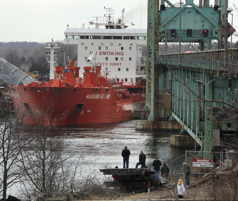 The tanker the Harbour Feature rests against the Sarah Mildred Long Bridge in Kittery where it crashed Monday.