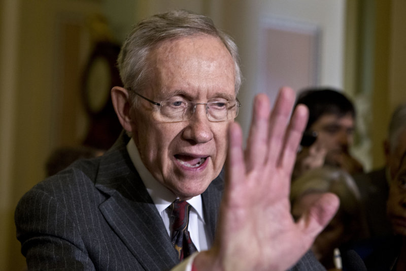 Senate Majority Leader Harry Reid, D-Nev., arrives to speak with reporters following a Democratic strategy session at the Capitol in Washington, Tuesday, April 9, 2013. Reid said he plans showdown vote on gun control on Thursday . (AP Photo/J. Scott Applewhite)