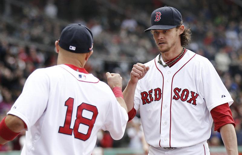 Boston Red Sox starting pitcher Clay Buchholz fist bumps with Shane Victorino after the eighth inning, when he lost his bid for a no-hitter. Buchholz struck out 11 and allowed two hits in eight innings.