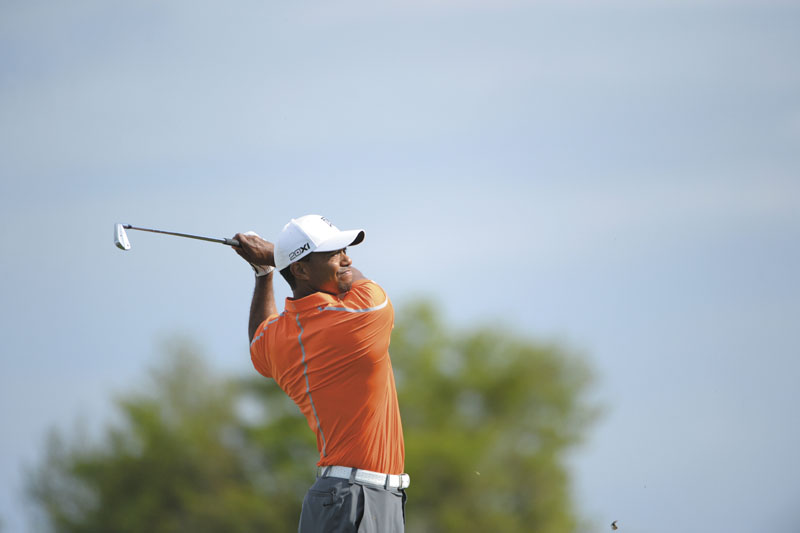 Tiger Woods watches his tee shot on the 14th hole during the second round of the Arnold Palmer Invitational golf tournament in Orlando, Fla., Friday, March 22, 2013.(AP Photo/Phelan M. Ebenhack)