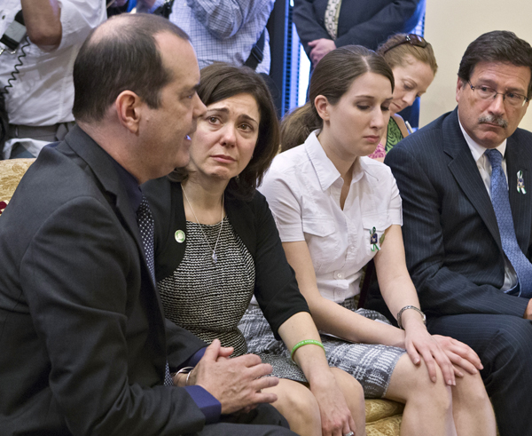 Families of victims of the Sandy Hook Elementary School shooting meet with Sen. Joe Manchin, D-W.Va., after he announced a bipartisan deal on expanding background checks on Capitol Hill on Wednesday. David and Francine Wheeler are at left.
