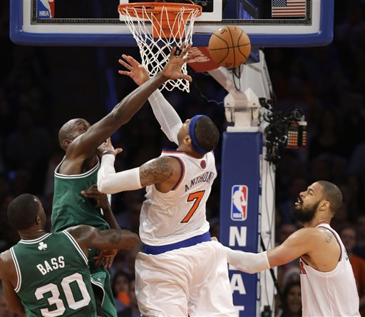 Boston Celtics center Kevin Garnett (5) deflects the ball from New York Knicks forward Carmelo Anthony (7) as Celtics forward Brandon Bass (30) and Knicks center Tyson Chandler (6) watch in the second half of Game 5 of their first-round NBA basketball playoff series at Madison Square Garden in New York, Wednesday, May 1, 2013. The Celtics won 92-86. (AP Photo/Kathy Willens)
