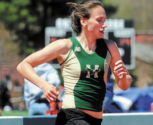 GIVING HER ALL: Husson College's Chrissy Larrabee competes in the women's 1,500-meter run in the New England Division III track and field championships Saturday at Colby College.