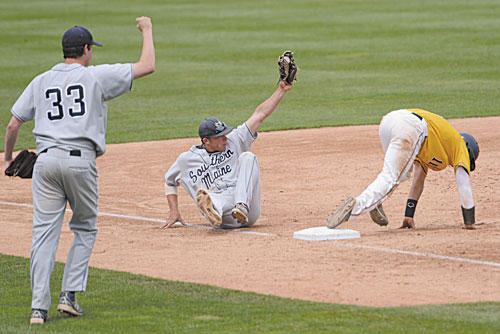 GOT HIM: University of Southern Maine's Nick Grady shows the ball after making a tag at third base for the first out of the eighth inning against Webster University in the Division III Baseball World Series on Sunday at Time Warner Cable Field in Appleton, Wis.