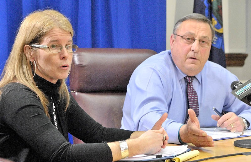 Department of Health and Human Services Commissioner Mary Mayhew, left, and Gov. Paul LePage answer questions during a news conference on Thursday in the State House in Augusta.