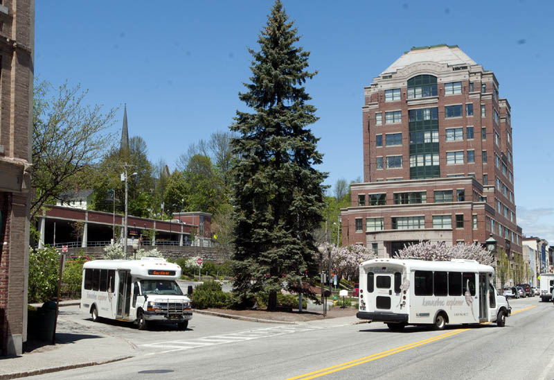 This photo taken on Friday shows Kennebec Explorer buses exiting Market Square in Augusta.