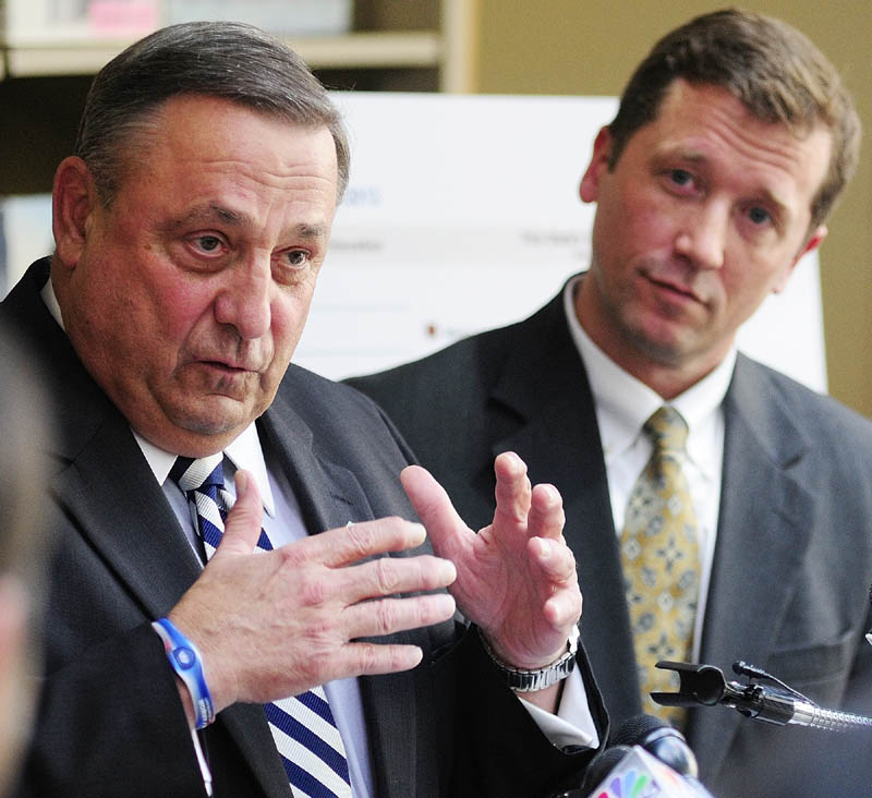 Gov. Paul LePage, left, and Education Commissioner Stephen Bowen unveiled the state's new A-F grading system on Wednesday at the Maine State Library. Gov. Paul LePage said the grades would make schools accountable.