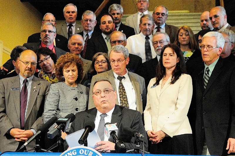 Moments after it was passed, Gov. Paul LePage reads his veto message of L.D. 1546,