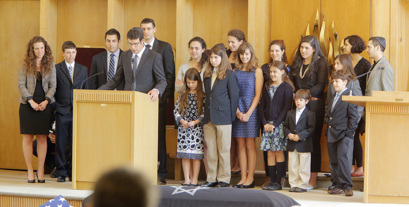 The grandchildren of Albert Glickman gather around the podium and tell stories of their grandfather at his funeral service at Temple Beth El in Portland on Wednesday, May 1, 2013. Glickman was a noted philanthropist who was known for his deep love of his family.