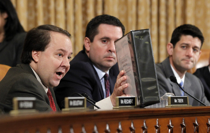 U.S. Rep. Pat Tiberi, R-Ohio, holds a folder from a conservative group, the Ohio Liberty Coalition, as he questions Miller.