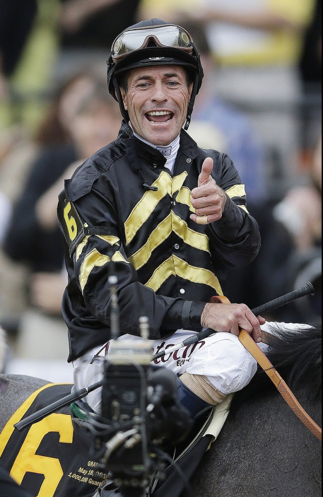 Jockey Gary Stevens, who came out of retirement in January, gives a thumbs-up after winning the 138th Preakness Stakes at Baltimore's Pimlico Race Course on Saturday.