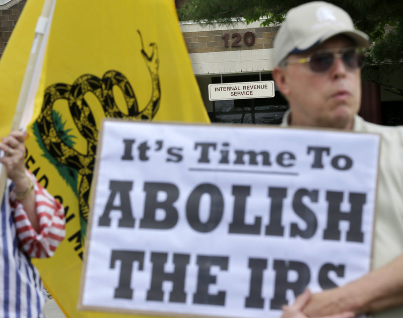 Cliff Toye joins others outside Internal Revenue Service offices in Cherry Hill, N.J., on Tuesday for a tea party rally protesting extra IRS scrutiny of conservative groups.