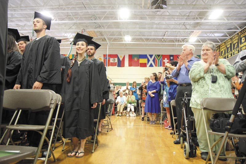 Unity College senior Angelica Morrison, 21, of Smithfield, R.I., smiles while she fellow soon-to-be graduates get a standing ovation at the start of the 44th commencement exercises on Saturday in Unity.