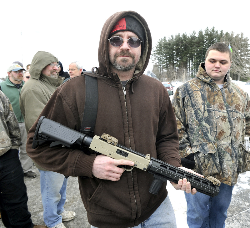 Ned Savage from Sidney, Maine lines up before for the Augusta Gun Show in January. A bill that would have mandated background checks before all gun sales, as well as certification or training before all purchases, has been significantly weakened, and will include neither of those measures.