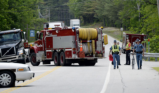 State police move the bike that was involved in a fatal crash in Hanover on Friday.