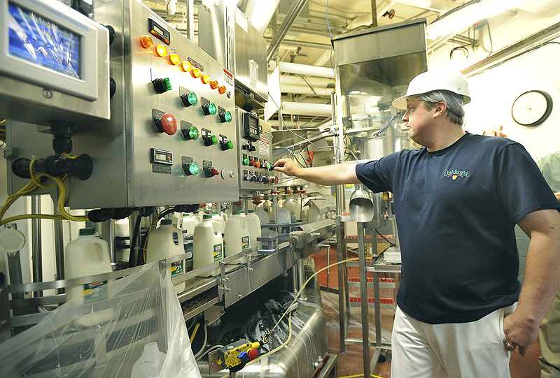 Filler operator Chris Roberts keeps a eye on controls at the Oakhurst Dairy plant in Portland.