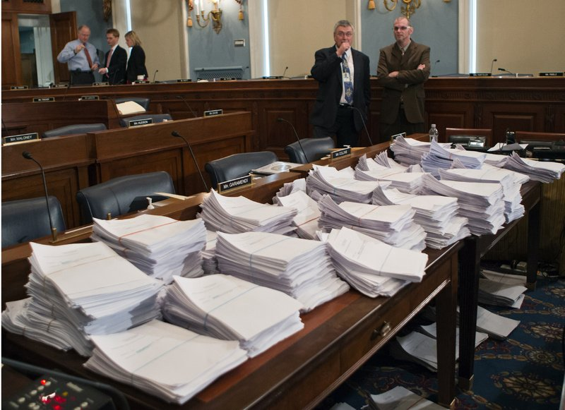 Stacks of paperwork await members of the House Agriculture Committee on Capitol Hill in Washington in May, as it met to consider the proposed Farm Bill.