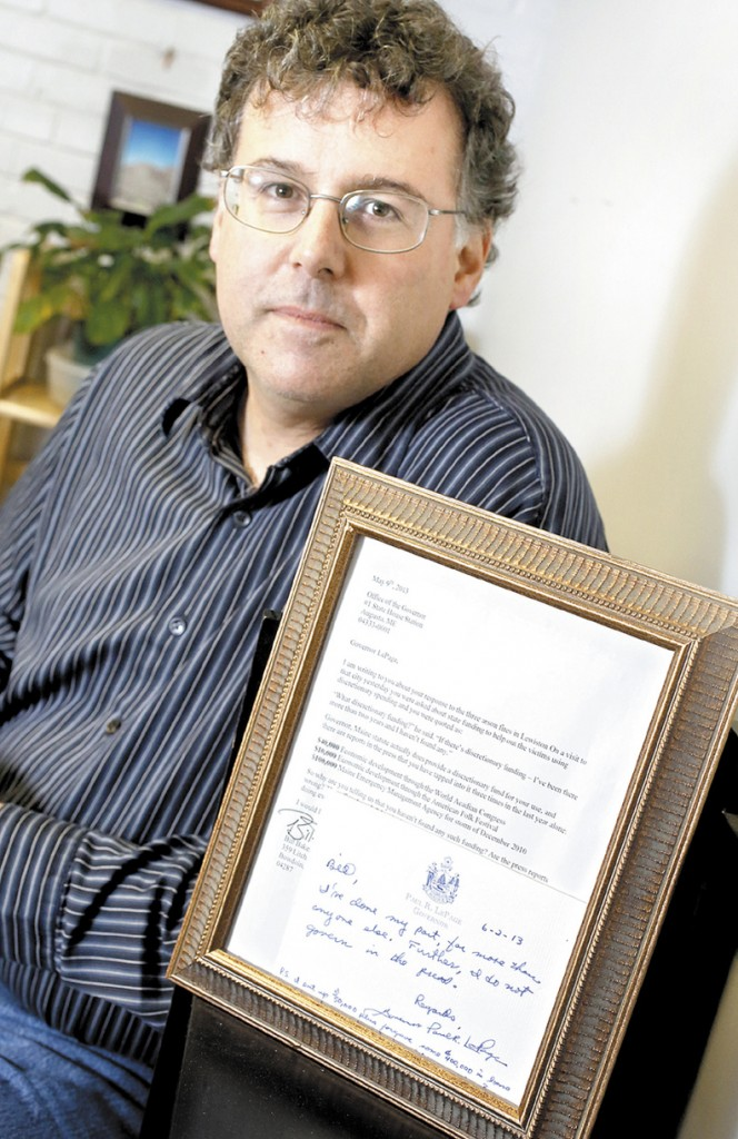 Bill DiGiulio with the letter he wrote to Governor LePage and the handwritten letter in response from the governor in his office in Portland on June 12.