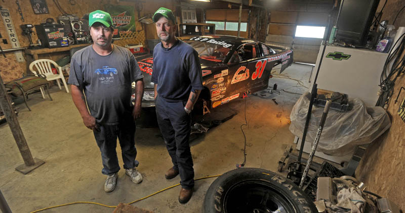 """NEW CHALLENGE: Unity Raceway Late Model driver Brent """"Poochie"""" Chase, left, and his crew chief Kevin Poulin, stand by the car in Poulin's garage in Detroit on Friday. Chase is racing Late Models for the first time and Poulin is a crew chief for the first time."""