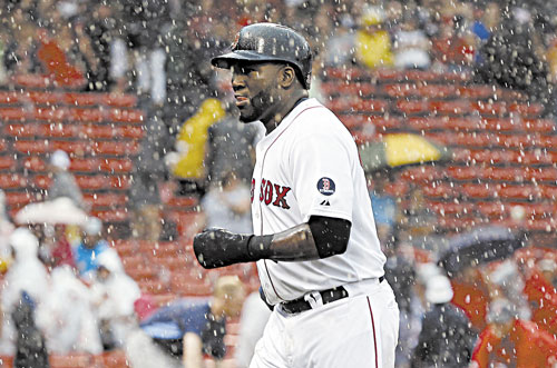 GET OUT OF HERE: Boston's David Ortiz jogs off the field during a rain delay in the fifth inning against the Tampa Bay Rays in the first game of a doubleheader Tuesday in Boston.