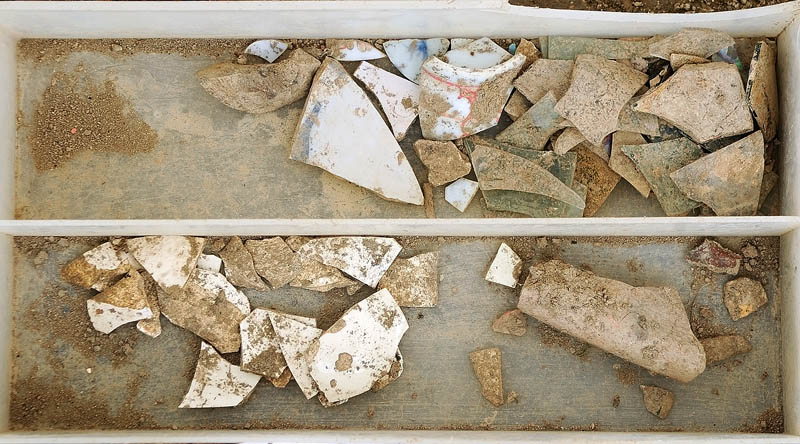 A tray holds items uncovered during an archeological dig on Tuesday at the Fort RIchmond site, near the Kennebec River in RIchmond.