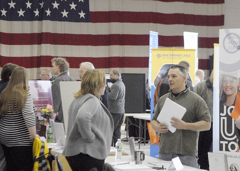Staff photo by Joe Phelan Stacey L. Morrison, chief executive officer of Ganneston Construction Corp., center left, chats with Jeff Dube, of Rome, during a job fair on Wednesday March 20, 2013 in the Augusta Armory. �Hiring Maine�s Heroes Job Fair� tomorrow, March 20th, at the Augusta Armory. It will feature special programs and information about employment opportunities. The job fair will take place from 10:00 a.m. to 3:00 p.m. at the Augusta Armory, 179 Western Avenue. The event is co-sponsored by the Employer Support of the Guard and Reserve (ESGR) and the Augusta CareerCenter. (Standalone)