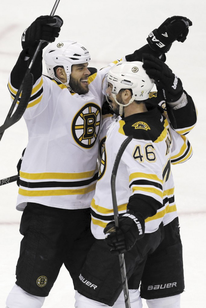 BACK ON THE ICE: Boston Bruins forward Nathan Horton, left, returned to practice Friday. Horton has been recovering from an upper body injury.