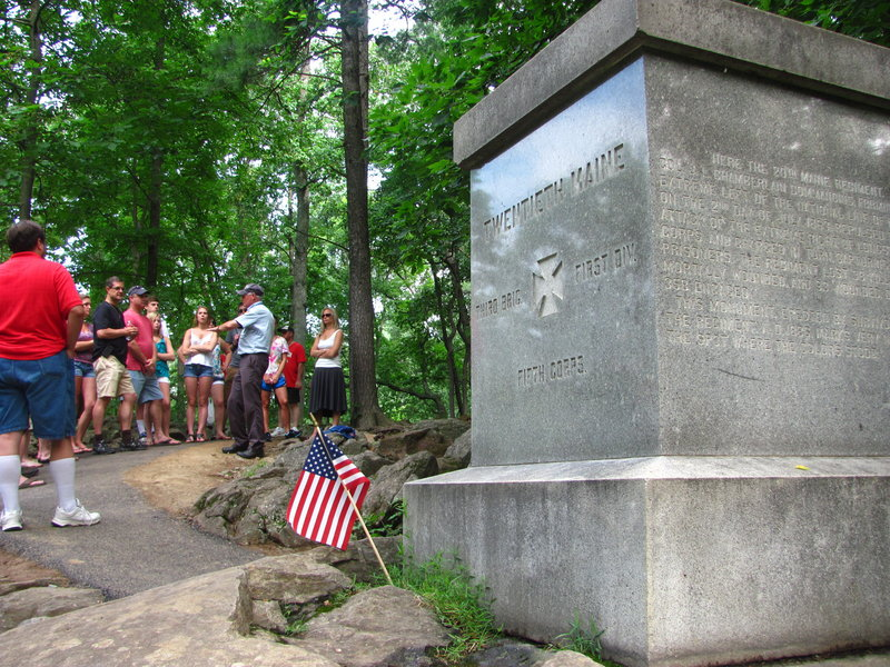 "A tour guide Sunday discusses the 20th Maine Regiment's bayonet charge on Little Round Top, which thwarted Confederate attempts to flank the Union lines at Gettysburg. Col. Joshua Chamberlain ordered the charge against the attacking forces because his troops were nearly out of ammunition and he was told to hold the far-left flank of the Union lines ""at all hazard."""